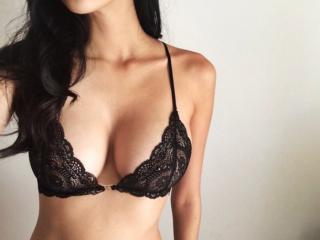 Foto de perfil sexy de la modelo CoquineDeliceX, ¡disfruta de un show webcam muy caliente!