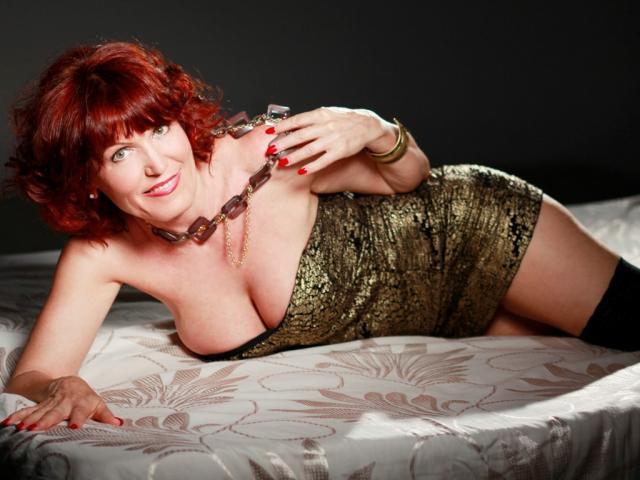 Foto de perfil sexy de la modelo RedHeadMature, ¡disfruta de un show webcam muy caliente!