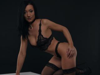 Foto de perfil sexy da modelo EroticXMia, para um live show muito quente!