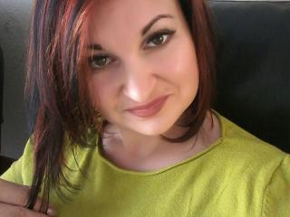 Foto van het sexy profiel van model ReynaKelly, voor een zeer geile live webcam show!